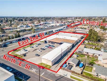 Remodeled Commercial Service/Industrial Building w/ Paved Yard - Madera