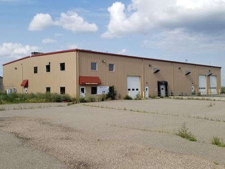 Former Pilot Thomas  Facility | +/- 20,000 SF Shop & Yard - Tioga