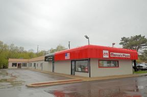 Commercial building on M59 west of Duck Lake Road