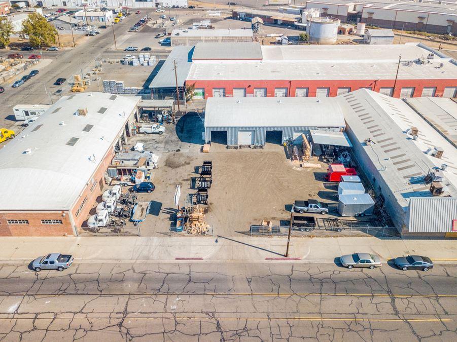 Freestanding ±15,500 SF Buildings + Land + Truck Repair Business