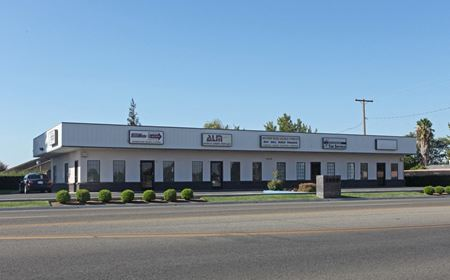 Professional Office Space Available + Existing Income - Madera